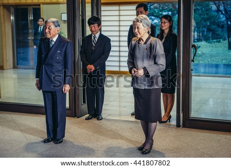 Tokyo, Japan - February 26, 2015: Emperor of Japan Akihito and Empress Michiko stands in front of entrance to Imperial Residence called Gosho - stock photo