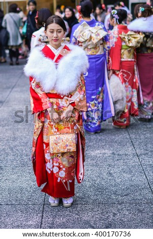 TOKYO, JAPAN - JAN 4: Young people dressed in Kimono pictured on January 4th, 2016, in Tokyo, Japan. They wear the traditional costume during Shichi-go-san Festival at the Meiji-jingu shrine in Tokyo. - stock photo