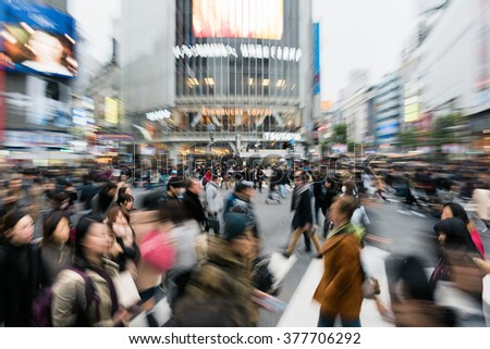 Tokyo, Japan - January 17, 2016: Evening rush hour at the famous Shibuya Crossing in Tokyo, Japan. This area is known as one of the fashion centers of Japan. - stock photo