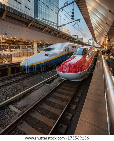 TOKYO, JAPAN - January 10: Shinkansen in Tokyo, Japan on Jan 10, 2014. Japan's main islands, are served by a network of high speed train lines that connect Tokyo with most of the major cities. - stock photo