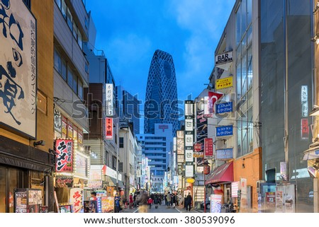 Tokyo; Japan -January 11; 2016: Street view of Nishi Shinjuku Shopping street whith several Japanese Restaurants on the sides. Mode Gakuen Cocoon Tower is at the background.