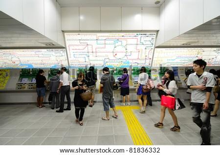TOKYO, JAPAN - JULY 4: Averaging 2.4 million passengers on an average weekday, Shibuya Station is Japan's 4th largest station on July 4, 2011 in Tokyo, Japan. - stock photo