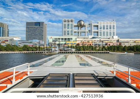 TOKYO, JAPAN - JULY 15, 2015: Cruise ship on Sumida river go to Odaiba and Fuji TV Building in Minato district