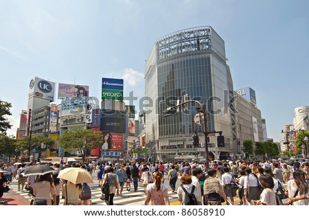TOKYO, JAPAN - JULY 9: Shibuya crossing is one of the most famed examples of a scramble crosswalk in the world on July 9, 2011 in Tokyo, Japan. - stock photo
