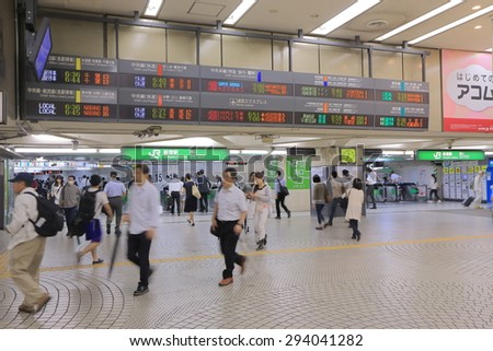 TOKYO JAPAN - JULY 1, 2015: Unidentified people travel at Shinjuku train station. Shinjuku train station is the busiest train station in the world used by more than 2 million people every day.  - stock photo