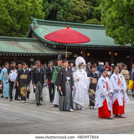 Tokyo, Japan - June 5, 2016: A traditional Japanese wedding ceremony at Shrine. Wedding parties and family members parade through the inner ground of the Meiji Jingu Shrine.
