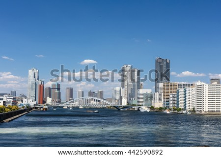 TOKYO, JAPAN - JUNE 2: view of the Kachidoki Bridge and Sumida river with the harbor area in Tokyo, Japan on June 2, 2016.