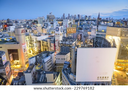 TOKYO, JAPAN - MARCH 31, 2014: Cityscape view over the Shibuya. Shibuya is a famed fashion center and nightlife area. - stock photo