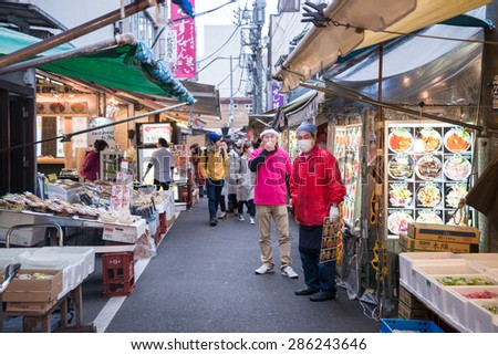 Tokyo, Japan - March 03, 2015: Famous Tsukiji fish market shops. Tsukiji is the biggest fish market in the world, with a vast varaiety of Fish and Sea food - stock photo
