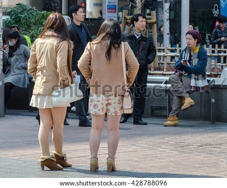 TOKYO, JAPAN - MARCH 12, 2014: Girls on Shibuya crossing