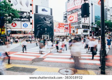 TOKYO, JAPAN - March 10, 2015: People walk across the crosswalk at shibuya street.,vintage,Japaness style - stock photo