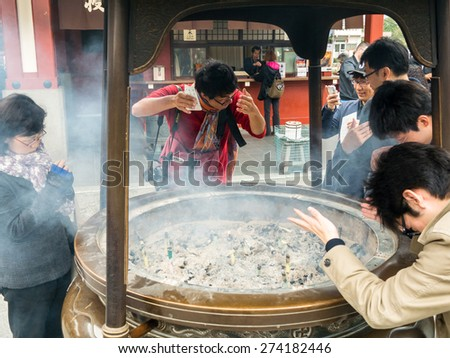 TOKYO, JAPAN - MARCH 18: Senso-ji Temple on March 18, 2015 in Tokyo, Japan. This Buddhist Temple is the symbol of Asakusa. - stock photo