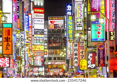 TOKYO, JAPAN - MARCH 14, 2014: Signs densely line an alleyway in Kabuki-cho. The area is a renown nightlife and red-light district. - stock photo