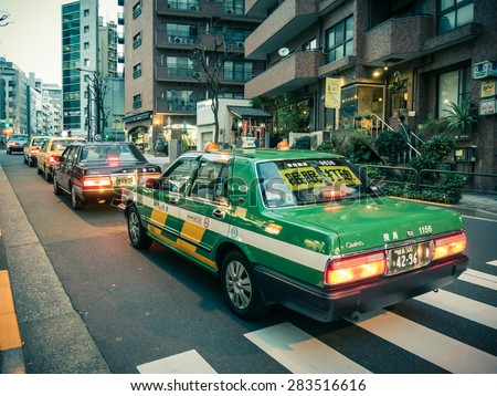 TOKYO, JAPAN - MARCH 20: Taxi in Shibuya district on March 20, 2015 in Tokyo, Japan. The district is a famed youth and nightlife center. - stock photo