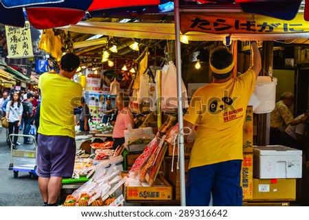 TOKYO,JAPAN - 9 May 2015 :Ameyoko is a busy market street along the Yamanote near Ueno Stations.various products such as clothes, fresh fish, dried food and spices are sold along here - stock photo