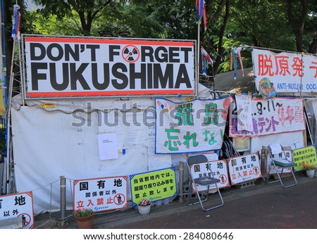 TOKYO JAPAN - MAY 8, 2015: Anti nuclear occupy tent. Anti nuclear occupy tent pitched near National Diet Building in Nagatacho. Nuclear issues in Fukushima have not been resolved yet.   - stock photo