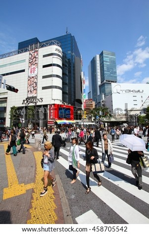 TOKYO, JAPAN - MAY 11, 2012: Crowds walk the Hachiko crossing in Shibuya, Tokyo. Shibuya crossing is one of busiest places in Tokyo and is recognized thanks to being featured in multiple films. - stock photo