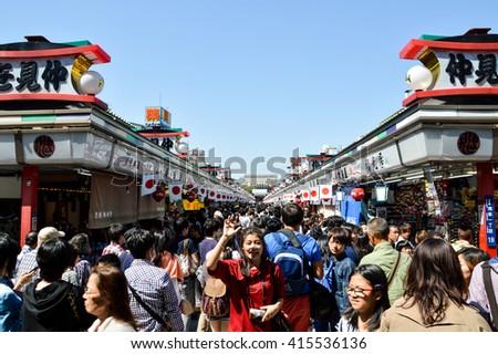 TOKYO, JAPAN - MAY 05, 2015: motion blur of people walking in nakamise shopping street - stock photo