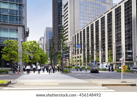 TOKYO, JAPAN - MAY 19: Office people during lunch break in business district Nishi-Shinjuku on May 19, 2016 in Tokyo, Japan. - stock photo