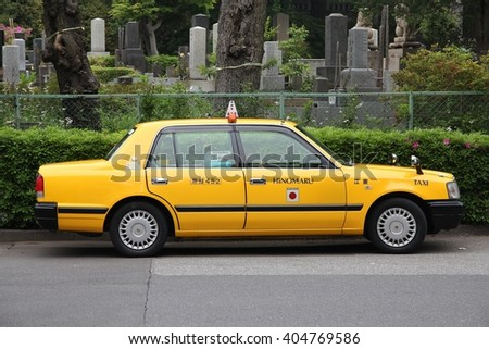 TOKYO, JAPAN - MAY 9, 2012: Taxi cab Toyota Crown in Tokyo, Japan. There are about 50,000 taxis in Tokyo.