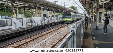 TOKYO, JAPAN - MAY 14TH 2016. Tokyo . Japan Rail Yamanote train station. Japan Railway train is a popular mode of transportation in Tokyo for people to commute. - stock photo