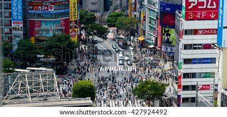 TOKYO, JAPAN - May 29, 2016: Tokyo, Japan view of Shibuya Crossing, one of the busiest crosswalks in the world. - stock photo