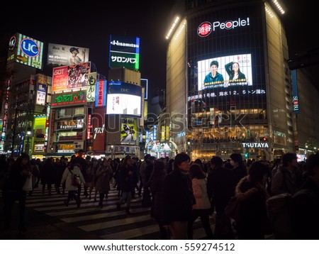 TOKYO,JAPAN - NOV 30,2016: People walk at SHIBUYA Crossing in night time, beautiful light from buildings