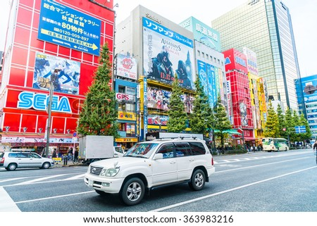 TOKYO, JAPAN - November 26, 2015: Crowded people traffic passes with colorful signs at Akihabara. The electronics and Toys district in Tokyo Japan.