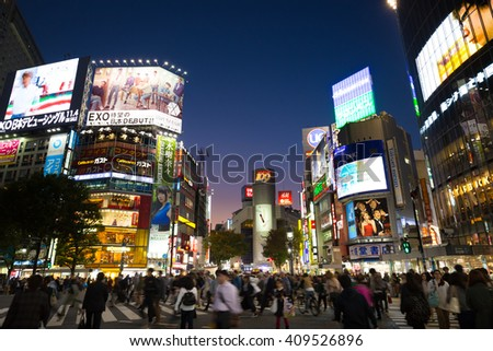Tokyo, Japan - November 6, 2015: Pedestrians cross at Shibuya Crossing on November 6th in Tokyo, Japan, 2015 . Shibuya Crossing is one of the busiest crosswalks in the world. - stock photo