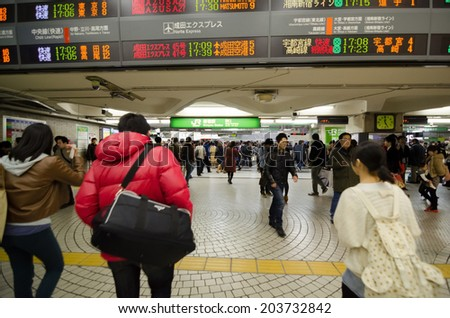 TOKYO, JAPAN - NOVEMBER 23, 2013 : people walking in Shinjuku train station on 23 November 2013. Shinjuku is one of the important district with one of the biggest train station in Japan.  - stock photo