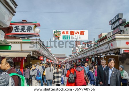 TOKYO,JAPAN - 24 November  2015 :Tourists walk on Nakamise Dori in Sensoji shrine.Sensoji temple with a variety of traditional, local snacks and tourist souvenirs for centuries.