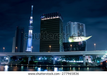 TOKYO,JAPAN-OCTOBER 26th :Tokyo sky tree and Asahi building in the night view beside the river in Tokyo,Japan on October 26,2014. - stock photo