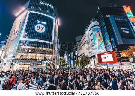 Tokyo, Japan, October 2017: Tokyo Shibuya crossing with people on the street and big lighted bilboards  in the night