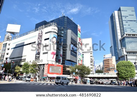 TOKYO, JAPAN - September 5, 2016: Pedestrians walk at Shibuya Crossing. The crossing is one of the world's most famous examples of a Scramble Crosswalk.