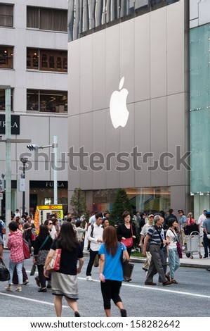 TOKYO, JAPAN - SEPTEMBER 22: Shoppers and tourists pass by a large Apple store in Ginza on September 22, 2013 in Tokyo, Japan.