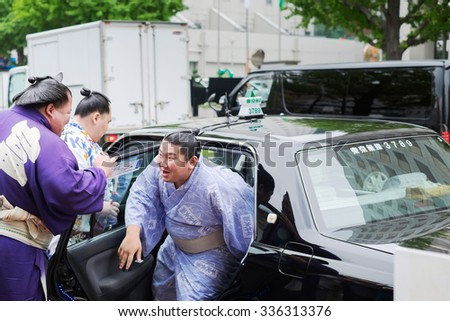 Tokyo, Japan - September 24: sumo wrestlers Fujiazuma Kazuyoshi with friends on September, 2015 in Tokyo, Japan. Sumo is Japan's national sport, most professional wrestlers are foreigners - stock photo