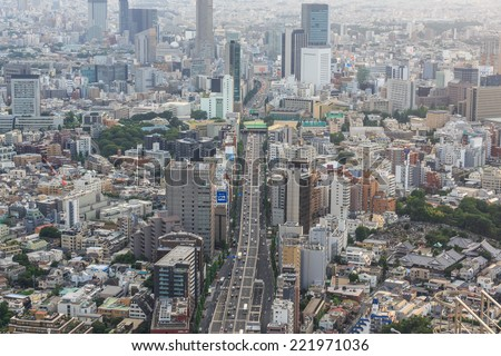 TOKYO - JUL 12: Tokyo Cityscape on Jul 12, 2014 in Tokyo. Tokyo is the capital of Japan, the center of the Greater Tokyo Area, and the most populous metropolitan area in the world. - stock photo
