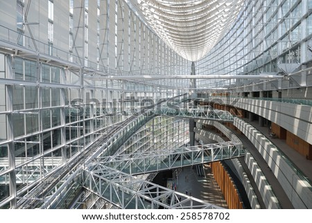 TOKYO - JULY 31, 2014: Lobby gallery of Tokyo International Forum in Chiyoda ward, Tokyo.  Completed in 1996, this 11-story building is a convention center.  - stock photo