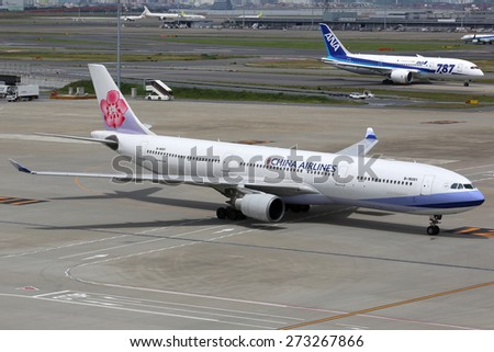 TOKYO - MAY 27: A China Airlines Airbus A330 on May 27, 2014 in Tokyo. China Airlines is the flag carrier airline from Taiwan headquartered at Taipei Taoyuan airport. - stock photo