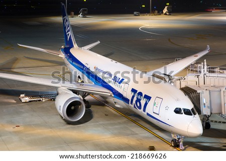 TOKYO - MAY 26: An ANA All Nippon Airways Boeing 787 Dreamliner on May 26, 2014 in Tokyo. The Boeing 787 Dreamliner is the world's first airliner to use composite materials in the construction. - stock photo