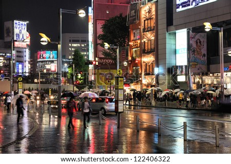 TOKYO - MAY 9: People shop in rain on May 9, 2012 in Shinjuku district, Tokyo. Shinjuku is one of the busiest districts of Tokyo, with many international corporate headquarters located here.