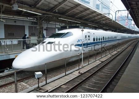 TOKYO - MAY 17: Shinkansen bullet train at Tokyo railway station in May 17, 2012 Tokyo, Japan.Shinkansen is world's busiest high-speed railway operated by four Japan Railways companies. - stock photo