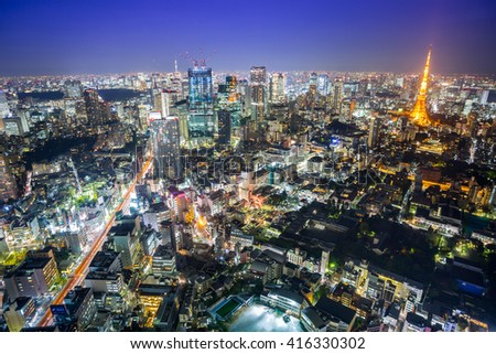 TOKYO - NOV 06: The Tokyo Tower lights up the skyline on November 06, 2015 in Minato Ward in Tokyo, Japan. With over 35 million people, Tokyo is the most populated metropolitan area in the world.  - stock photo