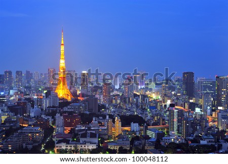 TOKYO - OCT 17: The Tokyo Tower lights up the skyline on October 17, 2011 in Minato Ward in Tokyo, Japan. With over 35 million people, Tokyo is the most populated metropolitan area in the world.