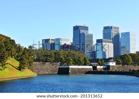 Tokyo panorama as seen from imperial gardens in Chiyoda district - stock photo
