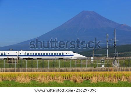 TOKYO - September 29: Shinkansen bullet train at Tokyo railway station in September 29, 2014 Tokyo, Japan. The Tokaido Shinkansen operate between Tokyo and Osaka and stop at Yokohama, Nagoya, Kyoto. - stock photo