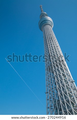 Tokyo sky tree with airplane trail in the sky. - stock photo