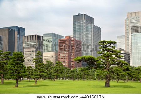 Tokyo skyline as seen from the Imperial Palace Gardens, Marunouchi district, Tokyo. - stock photo