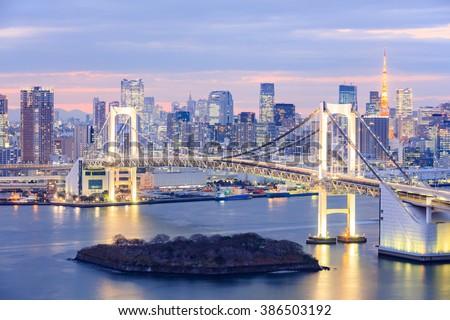 Tokyo skyline with Tokyo tower and rainbow bridge in Tokyo, Japan. - stock photo
