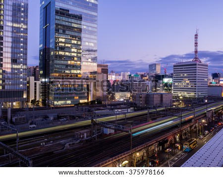 Tokyo skyscrapers and trains - stock photo